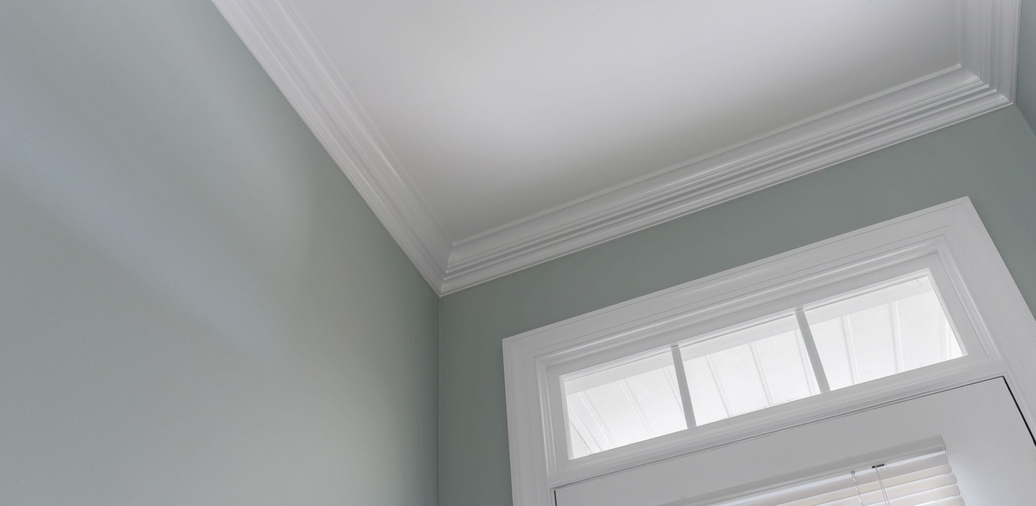 Notice the attention to detail and sharp painting of the crown molding, front door and door casing.